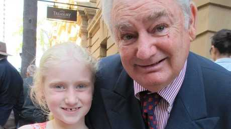 Proud grandfather and returned serviceman Brian Wade with granddaughter Heaven Hales, 7, at the Brisbane Anzac Day parade. Heaven wears her great grandfather's medals.