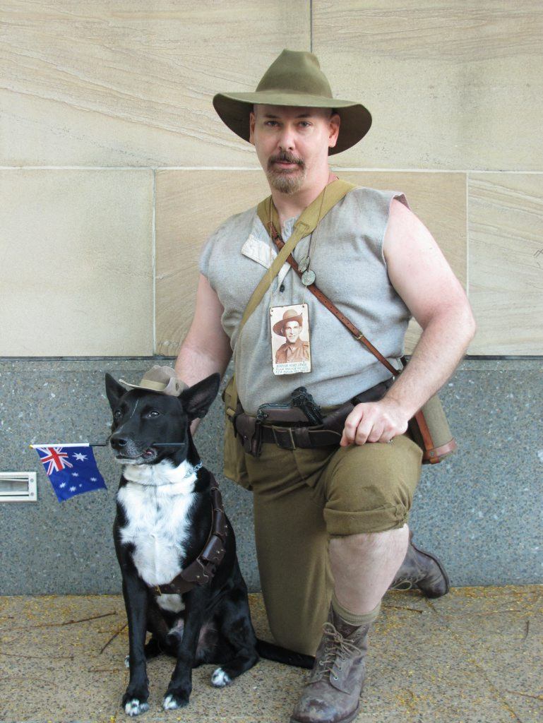 Coll Starry and Tuppy dog raise awareness about service dogs at the Anzac Day parade in Brisbane.