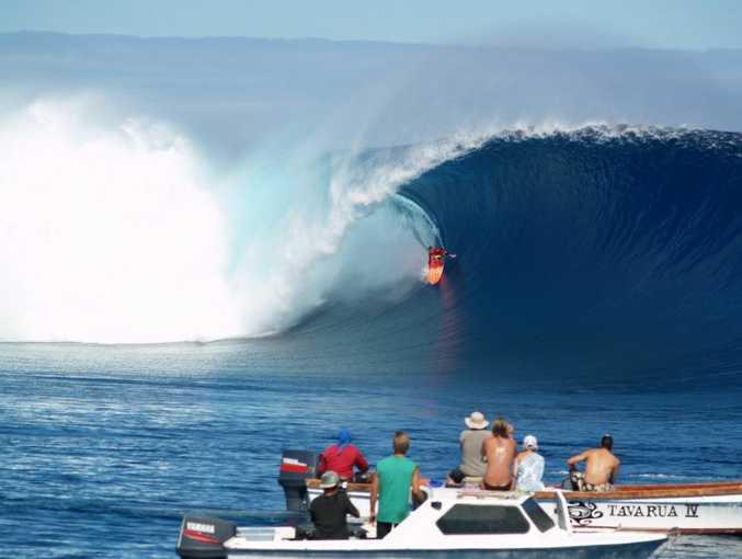 A surfer enjoying the waves at Cloudbreak in Fiji.