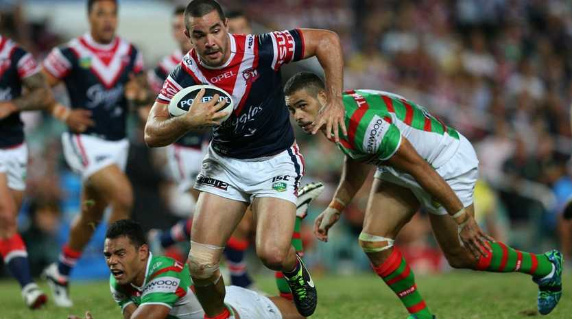 Aidan Guerra of the Roosters makes a break during the round one NRL match between the Sydney Roosters and the South Sydney Rabbitohs at Allianz Stadium on March 7, 2013 in Sydney, Australia.