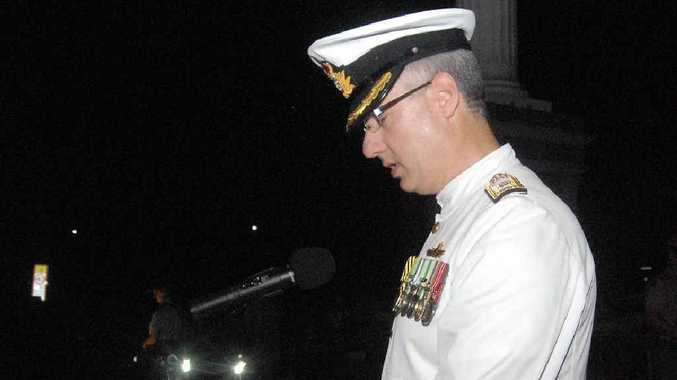 Commodore Peter Quinn speaks at the dawn service.