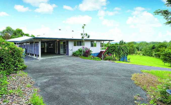 650 Hunchy Rd, offers a four-bedroom residence on 1.01ha in Hunchy.