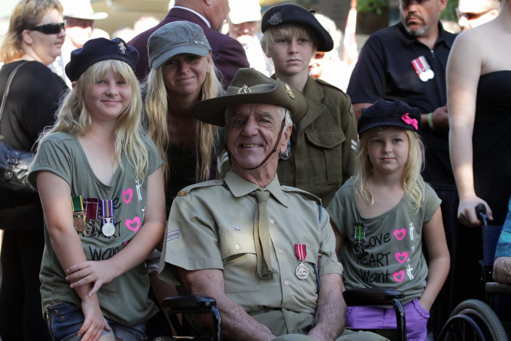 Warren Foster is chuffed to have such wonderful neighbours. Sky, Elizabeth, Beau and Summer Ivey organised a wheelchair enabling him to participate in the Anzac Day march.