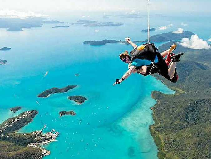 Two skydivers plunge in tandem after jumping out over the spectacular Whitsunday area.