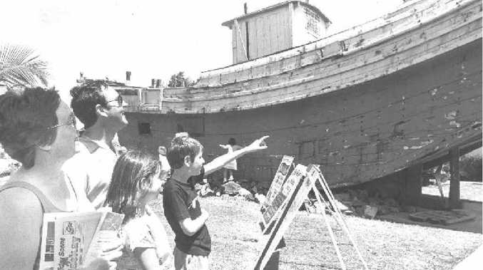 Middlemount family, Suzanne and Bill Ward, with children Melissa, 10, and Scott, 12, take a look at the old junk, which sat at the City Gates for many years. The family was enjoying a school holiday visit to Mackay in 1989.