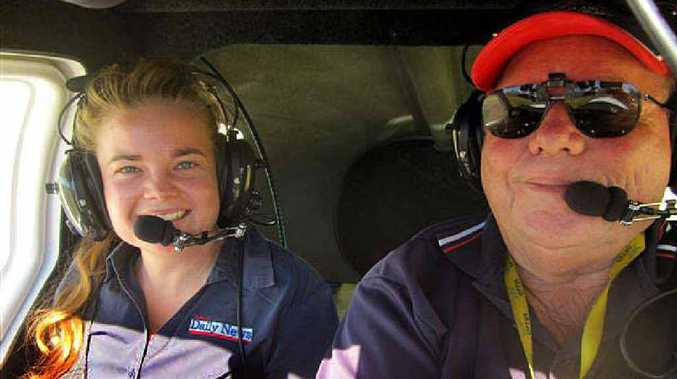Daily News reporter Erin Smith and pilot Pete Lafrancke.