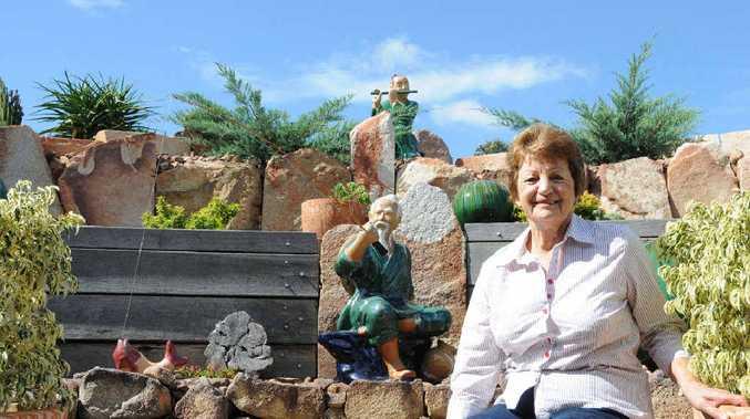 OVER THE MOON: Best town garden winner Gladys Gear celebrates her success.
