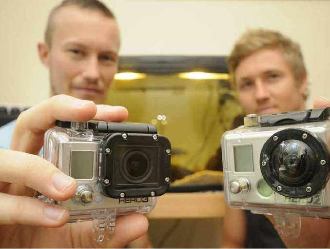 GOTCHA GOPRO: Aaron Briggs and Adam Cavanagh with two GoPro Hero cameras. One was lost four months ago at Byron Bay and was washed up at Salty Lakes, Evans Head last week.
