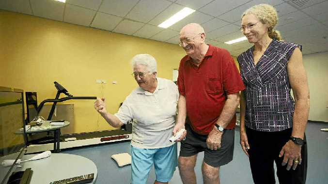 COMPUTER GAMES: Mavis and George Newell of Goonellabah with Dr Suzanne Broadbent as they play Wii games at Southern Cross University yesterday.
