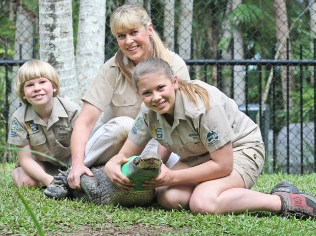 Robert and Bindi Irwin, pictured with mum Terri and Macca during the kids first alligator jump and relocation experience at the Australia Zoo.