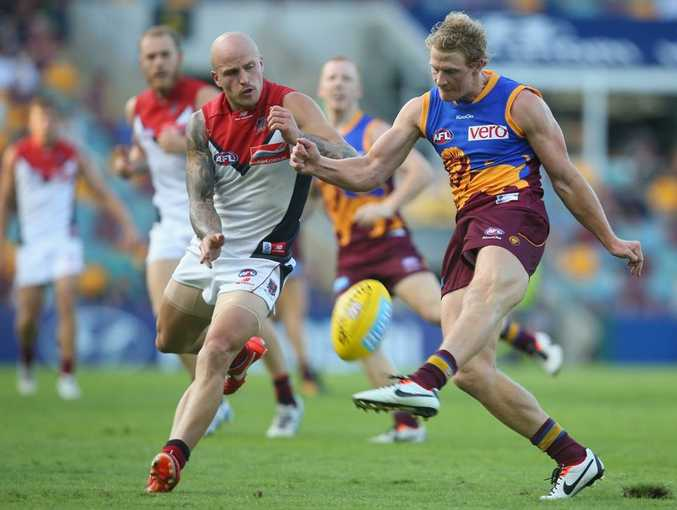 Mitch Golby of the Lions kicks during the round five AFL match between the Brisbane Lions and the Melbourne Demons at The Gabba on April 28, 2013 in Brisbane, Australia.