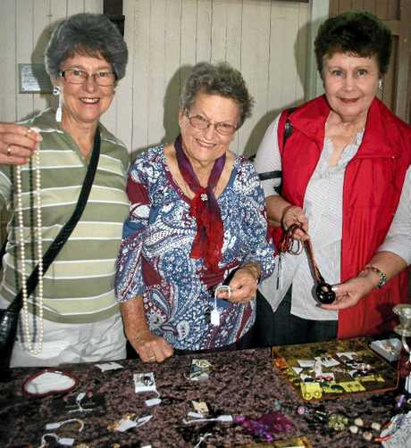 Janice Mundey, Jarj Mogridge and Margaret Ragh admire the jewellery on sale at the jewellery expo at St Mark's Hall on Saturday.