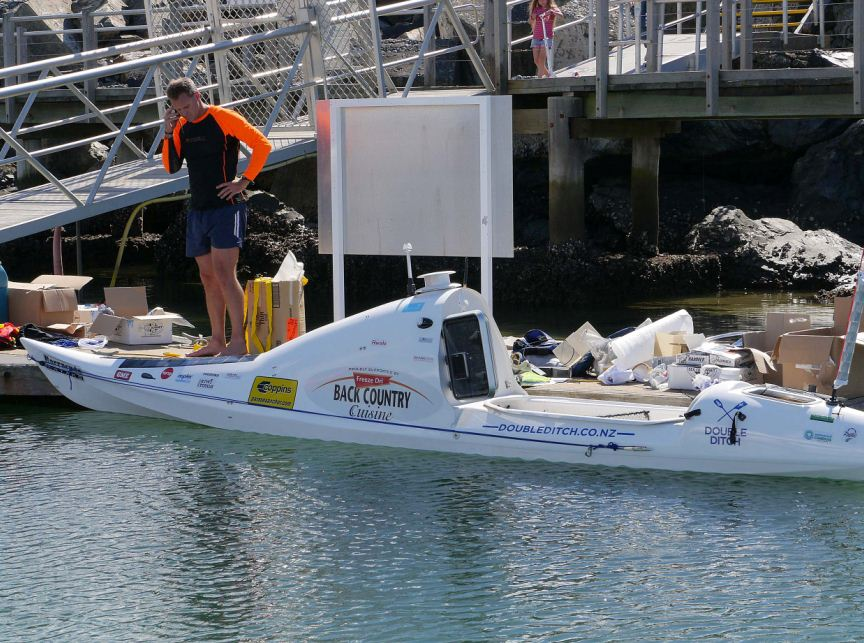 Scott Donaldson setting up his kayak before paddling out from Coffs Harbour on Thursday.