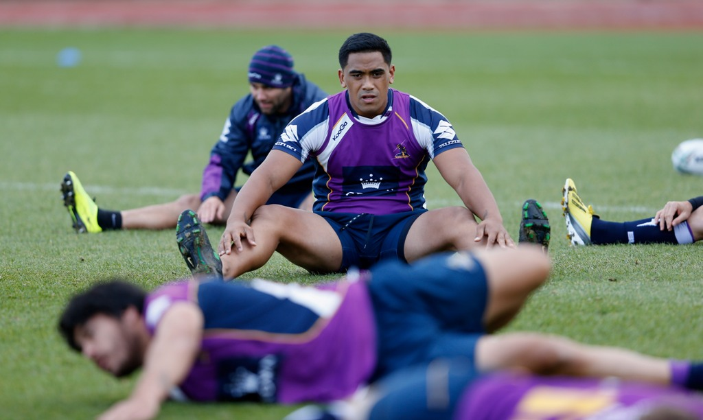 Junior Moors of Melbourne warms up during the Melbourne Storm training session on February 15, 2013.