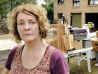 LEFT DEVASTATED: Karen Prestidge stands outside her Nimerette St property while tradesmen clean up the mess.