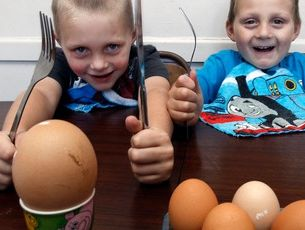 Alan Le Grice-Jones (left) and Logan Le Grice-Jones with the unusually large egg which would need an army of toast soldiers to knock off.