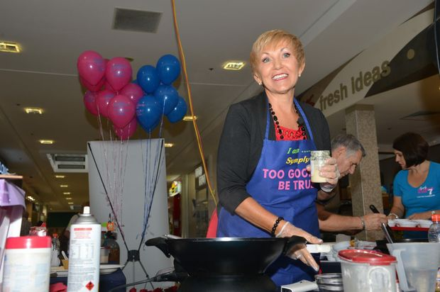 Annette Sym launches her latest cookbook. Annette demonstates her cooking to the crowd. Photo: Warren Lynam / Sunshine Coast Daily