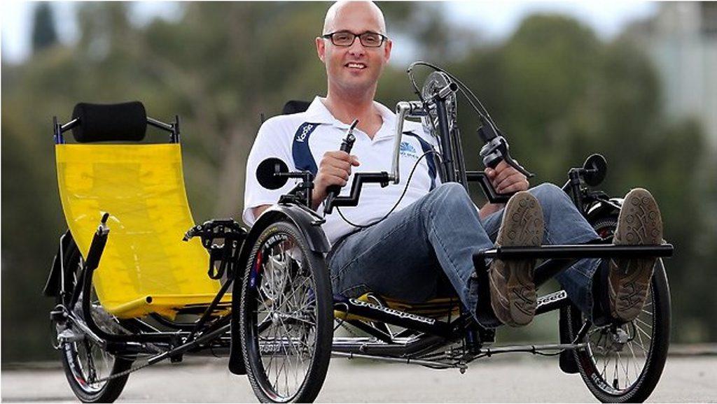 Dr Ian Davis in his customer made tandem bike, preparing for 'million meters' ride.