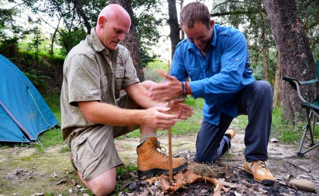 LOCAL FOCUS: Adventure Tag Tours owner Scott Belcher and Travel Bug host Morgan Burnett get a fire cracking.
