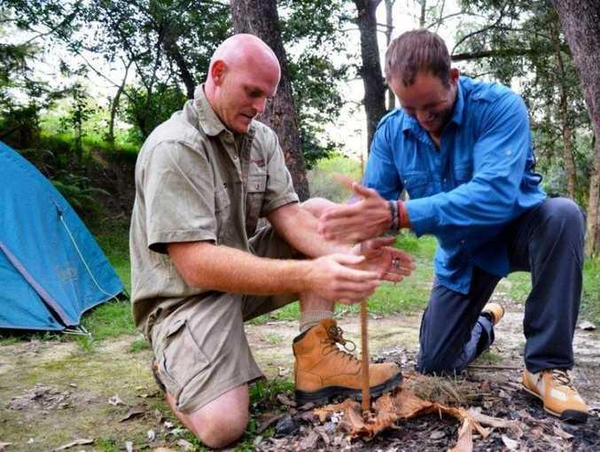 LOCAL FOCUS: Adventure Tag Tours owner Scott Belcher and Travel Bug host Morgan Burnett get a fire cracking.