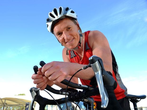 Andrew Gibson works as store manager of Coles, Pelican Waters, and has Multiple Sclerosis and taking part in the Hervey Bay Triathlon.