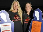 Vigil for 'faceless' thousands hurt by domestic violence