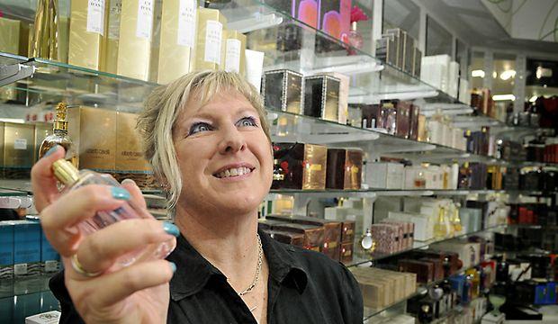 Deborah McKeon shares a spritz of perfume.