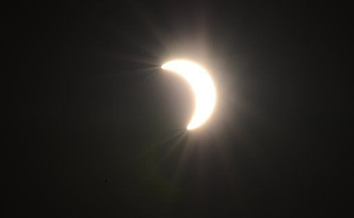 The eclipse as the moon passes in front of the sun.