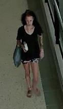 A CCTV image of a woman police want to speak to about fake $50 notes found at Byron Bay and Tweed Heads.