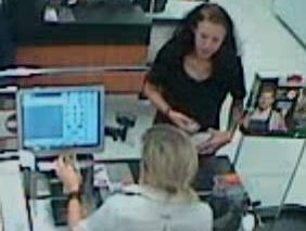 A CCTV image of a woman police want to talk to about fake $50 notes found at Byron Bay and Tweed Heads.