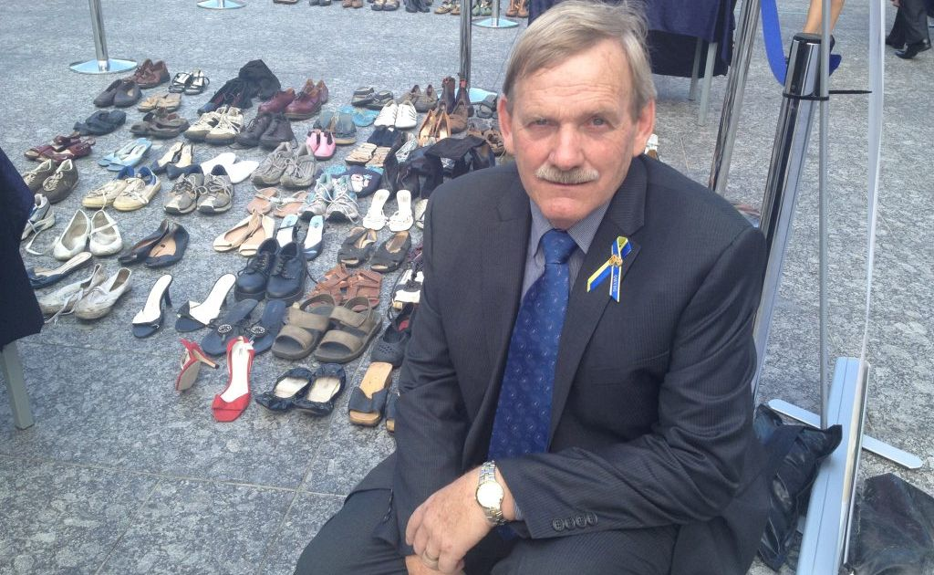 Homicide Victims Support Group general manager Ross Thompson, who lost his son Michael in a brutal murder at Toowoomba, at the Homicide Awareness Day in Brisbane. The shoes represent those who have been murdered.