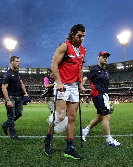 Taylor Walker of the Crows walks off on crutches after injuring his leg during the round five AFL match between the Carlton Blues and the Adelaide Crows at Melbourne Cricket Ground on April 27, 2013 in Melbourne, Australia.