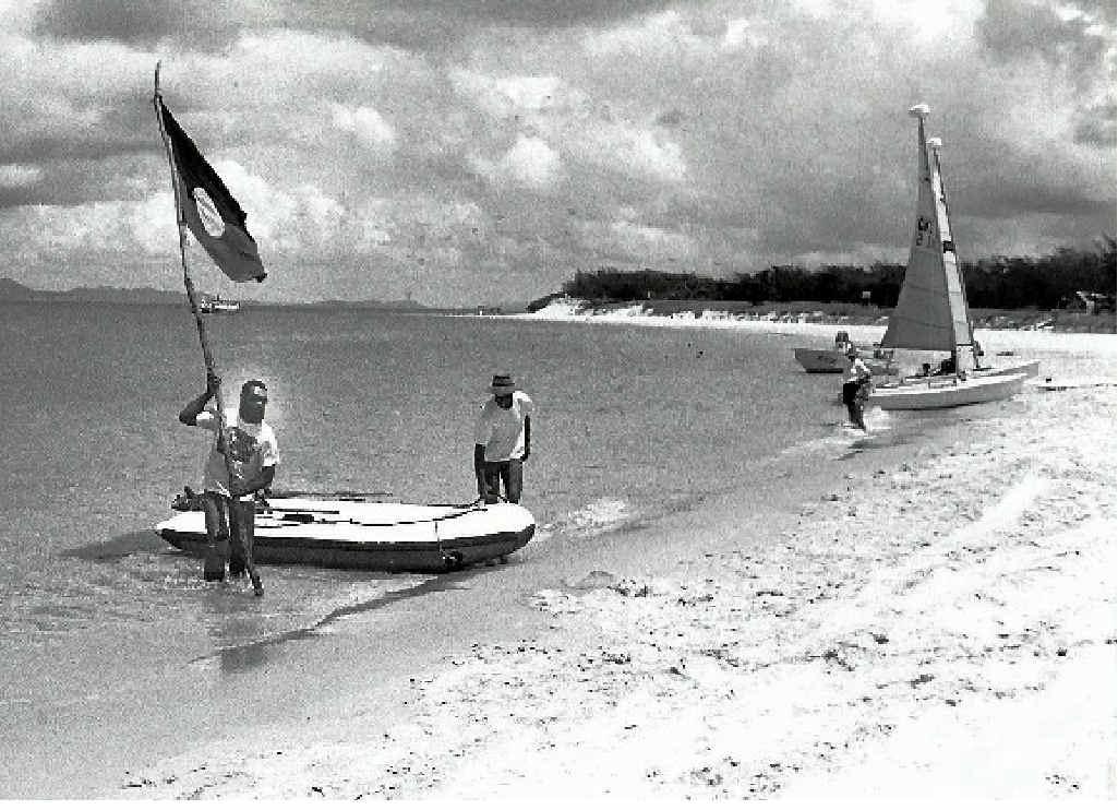 BELOW LEFT: Aboriginal elder Bob Muir places an Aboriginal flag on Great Keppel Island on Australia Day, 1993.