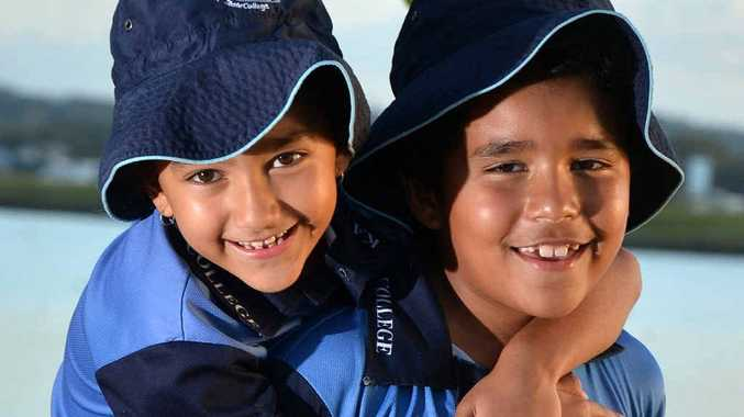TAKING THE BUS? Kawana twins Livai and Tara Sokovagone feature on Sunbus advertising their school.