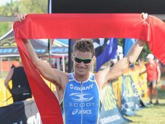 Hervey Bay Triathlon winner Bradley Kahlefeldt delighted after crossing the finish line.