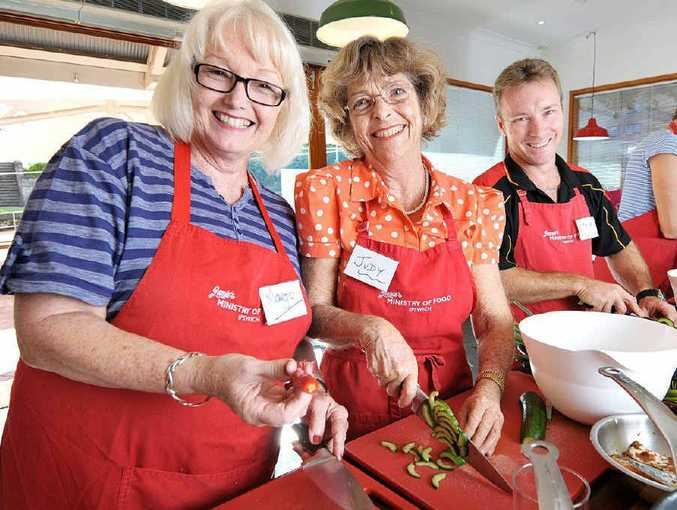 FRESH FOOD: Margot Igraf, Judy Cavanagh and Steve Kippen learn to cook at Jamie's Ministry of Food, which is celebrating its second birthday in Ipswich.