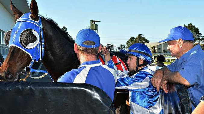 Jockey Adrian Coome and Craiglea Cruz return to scale and are met by trainer Peter Fleming (left) and owner Stan Johnston after winning the 2YO Plate (1200m) at Ooralea.