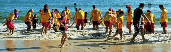 ON THE BEACH: Volunteers help kids with disabilities or special needs at the Noosa Heads SLSC lifesavers Sea Horse Nippers Day at Main Beach.