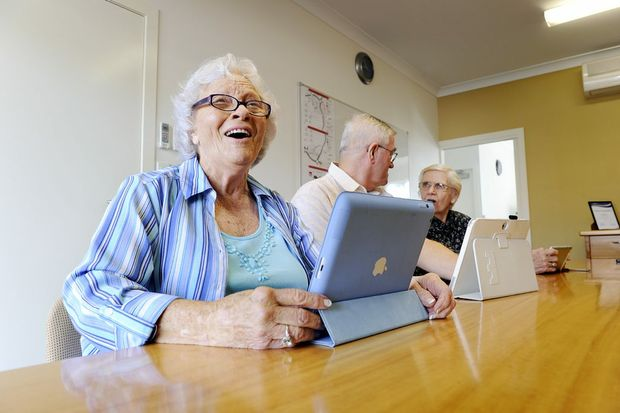 Vi Jorgensen with Graham parson and Lesley Burrows. Senior Net has extended its training program to include course for seniors using tablet devices. Photo: Claudia Baxter / The Queensland Times