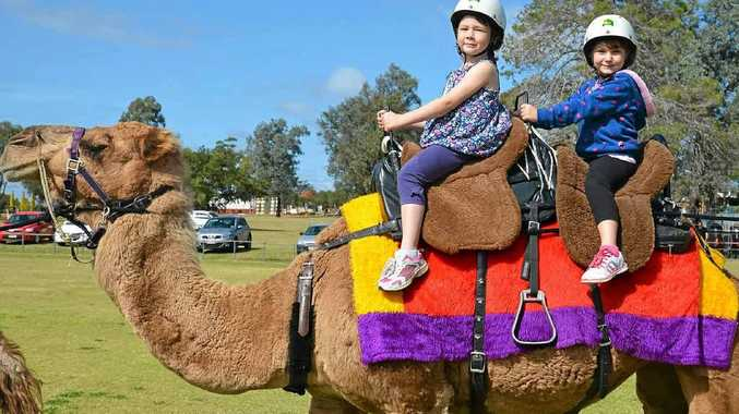 Frankie Collins and Breanna Brown take a camel ride.