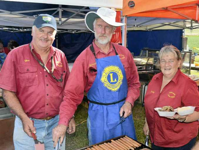 Glen Lamb, Howard Gant and Judith Petersen work on the Killarney Lions Club luncheon booth at the Heavy Horse Day.
