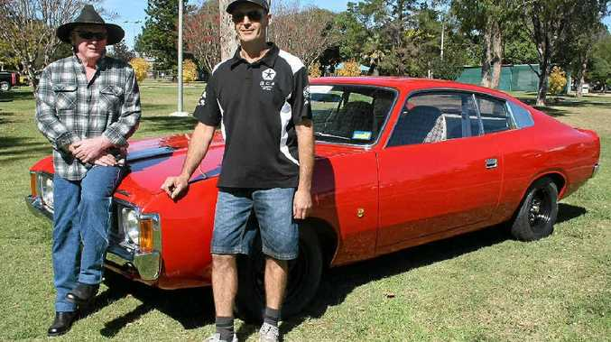 Local Ross Taylor checks out Stephen Kopp's '74 Sportsman Charger on display at Leslie Park.