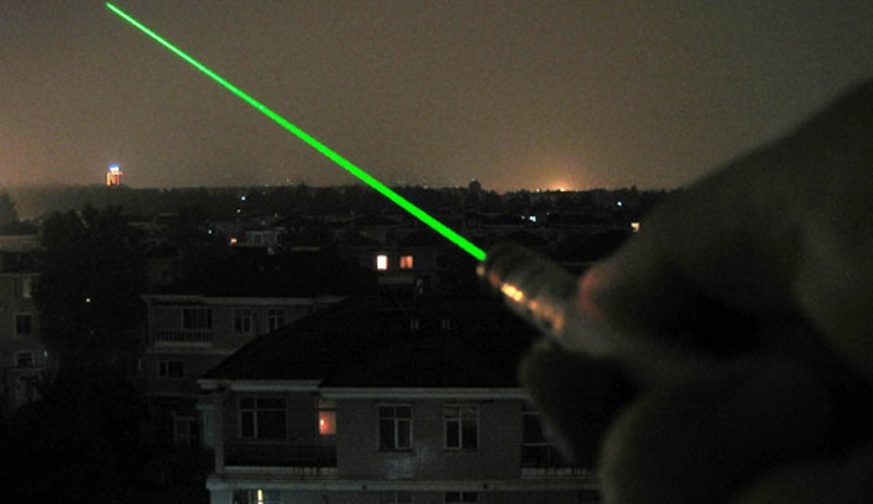 A man has been charged with shining a laser at an aircraft