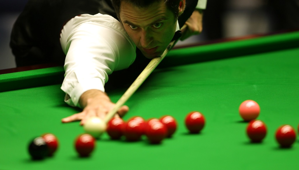Ronnie O'Sullivan of England in action against Barry Hawkins of England during the final of the Betfair World Snooker Championship at the Crucible Theatre on May 6, 2013 in Sheffield, England.