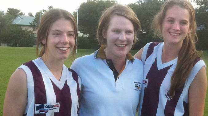 Coach Laura Kidd, centre, with Hannah Davidson, Rockhampton, and Mackay's Jordan Smyth.