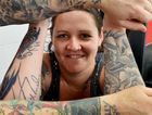 Mel Poole shows off her tattoos, alongside those of Maiden Ink Tattoos artist Mick Aplin.
