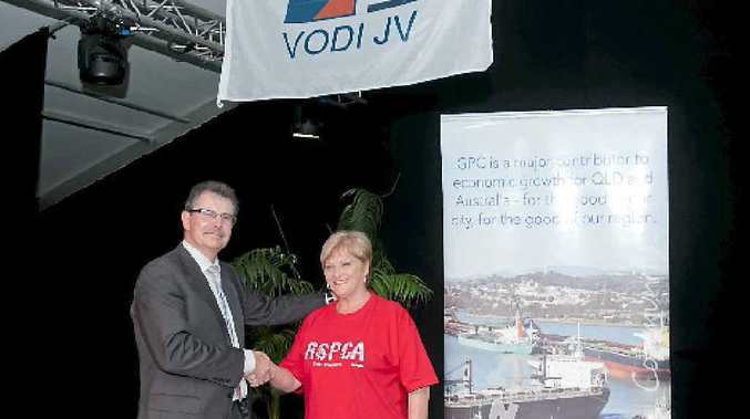 VODI project director Hedwig Vanlishout presents Friends of the RSPCA Gladstone president Judy Whicker with a $10,000 donation at an event to mark one million hours of injury-free dredging in Gladstone Harbour.