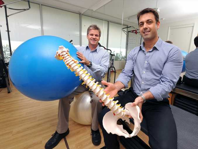 Simon Burley, left, and Sean Campbell celebrate 21 years of their business, Sports & Spinal Physiotherapy, at their Cotton Tree premises.