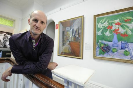 Lismore Art Gallery Director Brett Adlington with two Margaret Olley paintings that are part of their permanent collection. Photo Cathy Adams / The Northern Star