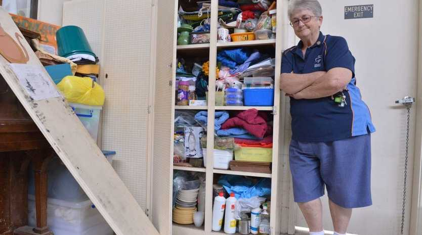 Marilyn Pritchard of Nambour District Guides inspects some of the damage done after a break in.